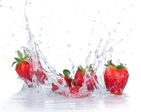 Foto de Fresh Strawberries with water splash over white background - Imagen libre de derechos