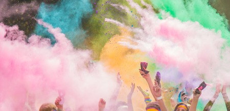 Photo for Close-up of marathon, people covered with colored powder. - Royalty Free Image