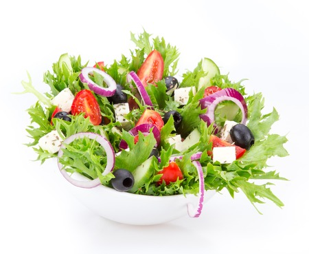 Foto de Fresh tasty salad isolated on white background - Imagen libre de derechos
