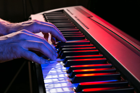 Photo for Close-up of pianist playing the piano. - Royalty Free Image