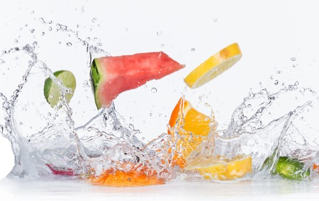 Foto de Fruits with water splashes isolated on white background - Imagen libre de derechos