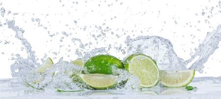 Foto de Fresh limes with water splashes isolated on white background - Imagen libre de derechos