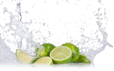 Photo for Fresh limes with water splashes isolated on white background - Royalty Free Image