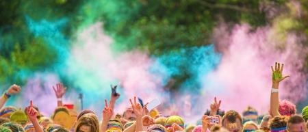 Foto de Close-up of color marathon, people covered with colored powder. - Imagen libre de derechos