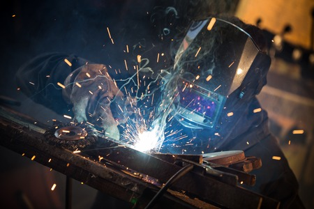 Photo for Working welder in action with bright sparks. - Royalty Free Image
