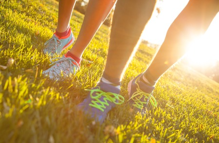 Photo for Runner legs outside during autumn day, close-up. - Royalty Free Image