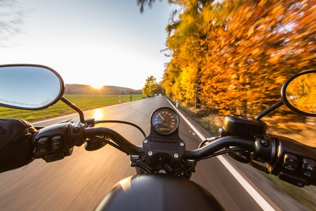 Foto de The view over the handlebars of a speeding motorcycle - Imagen libre de derechos