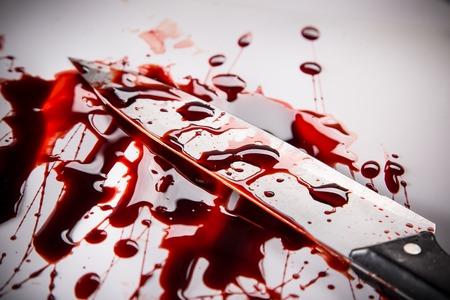 Photo pour Murder concept - knife with blood on white background, close-up. - image libre de droit