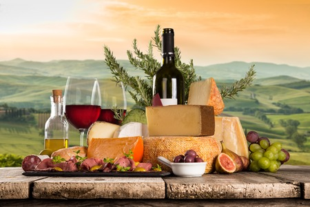Photo pour Delicious cheeses with wine on old wooden table. - image libre de droit