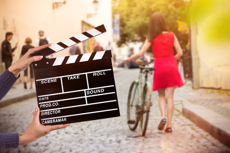 Photo for Clapperboard sign hold by female hands. - Royalty Free Image