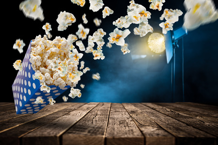 Foto de Popcorn explosion on old wooden table, close-up. - Imagen libre de derechos