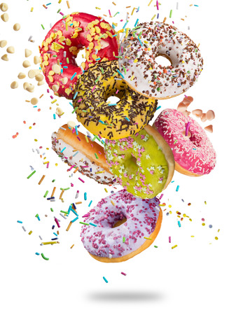 Photo for Tasty doughnuts in motion falling on white background, close-up. - Royalty Free Image