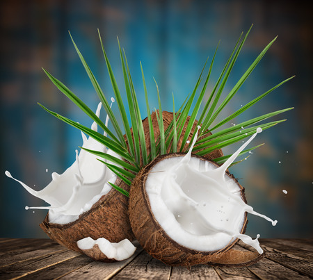 Photo for close-up of a coconuts with milk splash. - Royalty Free Image