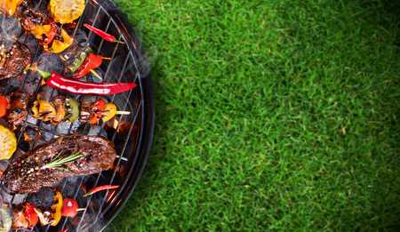 Foto de Barbecue grill with beef steaks, close-up. - Imagen libre de derechos
