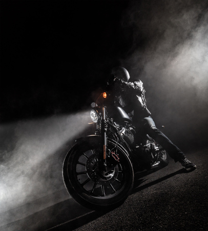 Foto de High power motorcycle chopper at night. Smoke effect on dark background. - Imagen libre de derechos