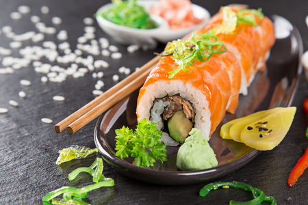 Photo for Japanese sushi set on a rustic dark background. - Royalty Free Image