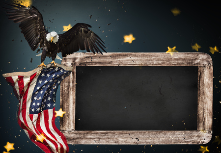 Photo pour Empty wooden table with bald eagle and flag. USA national holidays concept. - image libre de droit