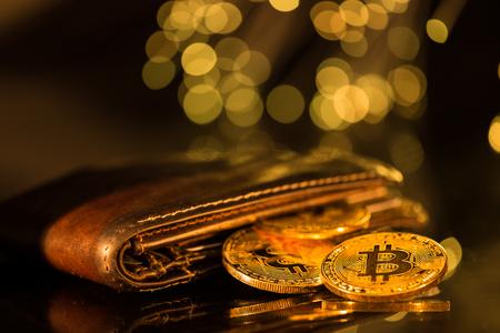 Foto de Bitcoin gold coins with wallet. Virtual cryptocurrency concept. - Imagen libre de derechos
