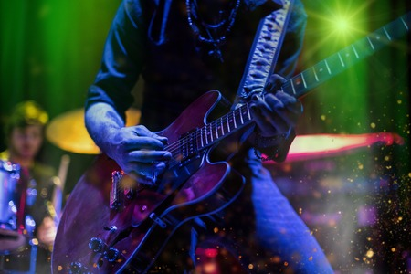 Photo pour Guitarist playing on electric guitar. Rock concert stage. - image libre de droit