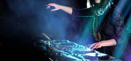 Photo for Dj mixes the track in the nightclub at a party, close-up. - Royalty Free Image