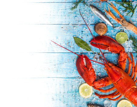 Photo pour Fresh tasty seafood served on old wooden table. Top view. Close-up. - image libre de droit