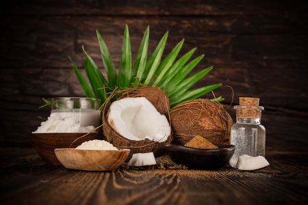 Photo for close up of a coconut oil on old wooden background - Royalty Free Image