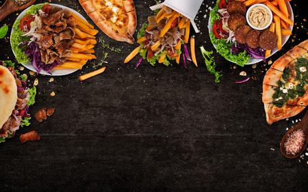 Photo pour Top down view on traditional turkish meals on black stone table. Close-up. - image libre de droit