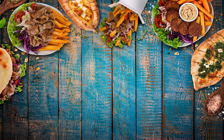 Photo pour Top down view on traditional turkish meals on vintage wooden table. Close-up. - image libre de droit
