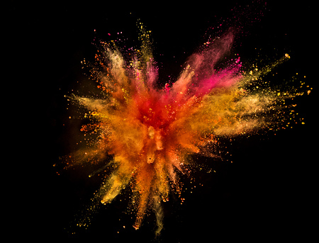 Photo pour Colored powder explosion isolated on black background. Freeze motion. - image libre de droit