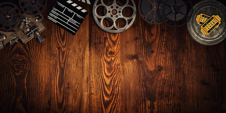 Photo for Cinema concept of vintage film reels, clapperboard and projector. - Royalty Free Image