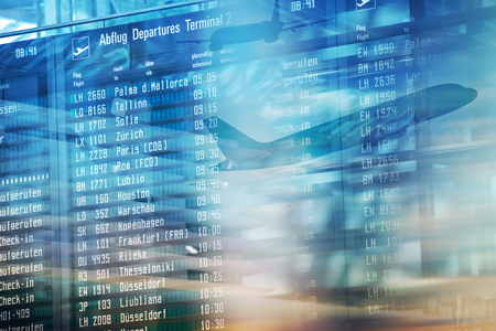 Photo for Flights information departures board in airport terminal. - Royalty Free Image