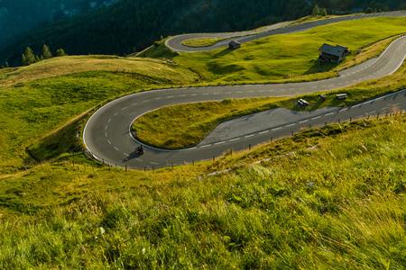 Foto de Motorcycle drivers riding in Alpine highway on famous Hochalpenstrasse, Austria, Europe. - Imagen libre de derechos