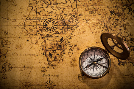 Photo for Old vintage navigation equipment on old world map. - Royalty Free Image