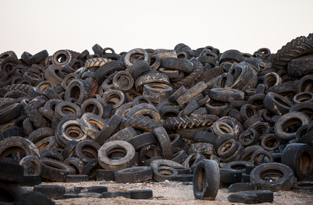 Photo for Old tyres polluting the nature - Royalty Free Image