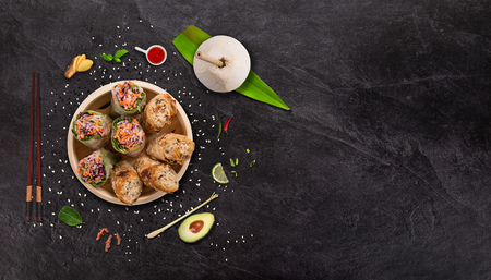 Photo for Spring rolls asian food  with various ingredients on stone - Royalty Free Image