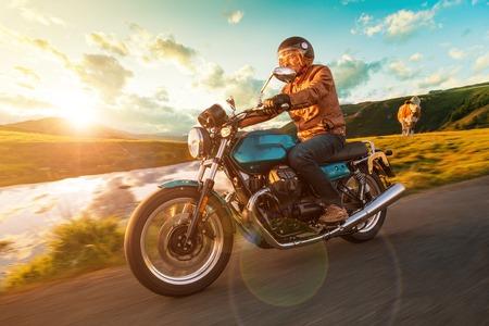 Foto de Motorcycle driver riding in Alpine highway, Nockalmstrasse, Austria, Europe. - Imagen libre de derechos