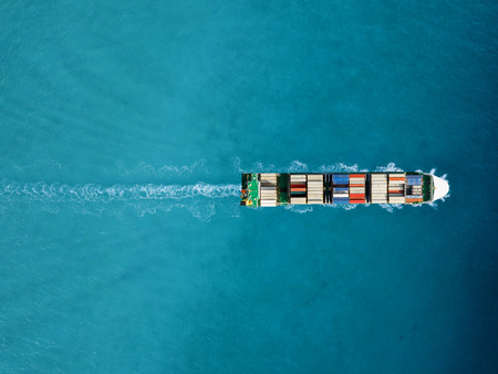 Foto de Container ship in export and import. International shipping cargo. - Imagen libre de derechos