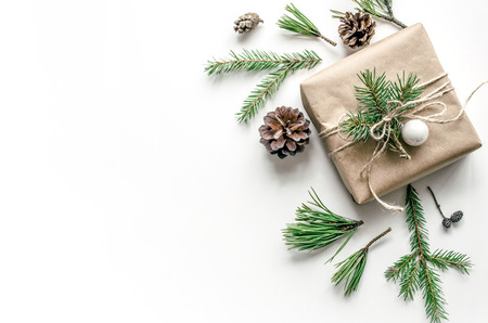 Photo pour Christmas composition with a gift on a white background. Eco-style. Christmas background for presentation of work or text. Copy space. Top view - image libre de droit
