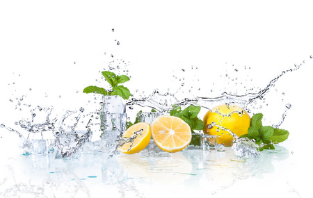 Foto de ice cubes and splashing water with mint and lemon on a white background - Imagen libre de derechos