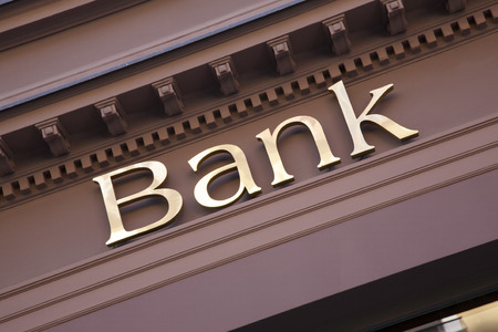 Photo pour Bank Sign on Branch Facade - image libre de droit