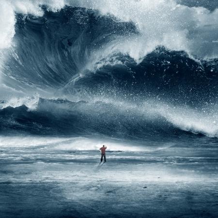 Huge Tidal wave crashing onto the beach with man