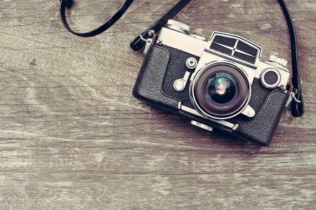Photo for A vintage camera on wooden background - Royalty Free Image