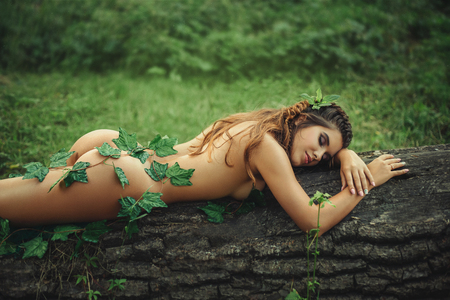 Photo for Sexy girl in clothes from leaves. Fantasy picture. Creative colors - Royalty Free Image