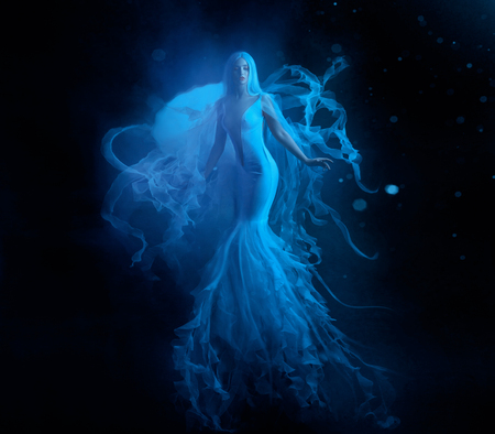 Foto de A white mermaid, with very long and blue hair floating under the water. An unusual image, the tail of a jellyfish. Levitation and weightlessness. Pale skin, gentle makeup. Art photo - Imagen libre de derechos