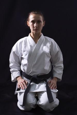 karate girl on black background studio shot