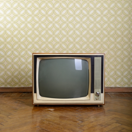 Photo for retro tv with wooden case in room with vintage wallper and parquet - Royalty Free Image