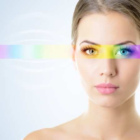Foto de beautiful woman's face with rainbow light on eyes - Imagen libre de derechos