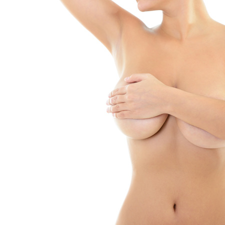 Photo pour Body of beautiful woman covering her breast and showing armpit, over white - image libre de droit