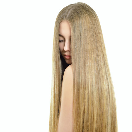 Photo pour Hair. Beautiful woman with long healthy shiny smooth hair. Attractive blond girl over white background. Gorgeous Hair. Hair care. - image libre de droit