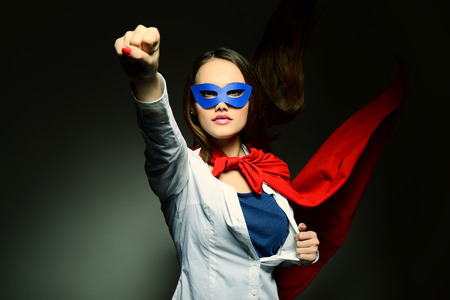 Photo pour Young pretty woman opening her shirt like a superhero. Super girl, image toned. Beauty saves the world. - image libre de droit